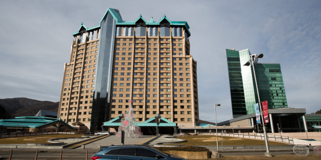 A vehicle drives past Kangwon Land Corp. hotel and casino building in Sabuk, Jeongseon, South Korea, on Wednesday, Dec. 21, 2016. The proliferation of gambling addicts in Sabuk is serving as a warning for lawmakers in South Korea -- and more recently Japan -- enticed by the potential for tax revenues and economic gains. Photographer: SeongJoon Cho/Bloomberg via Getty Images
