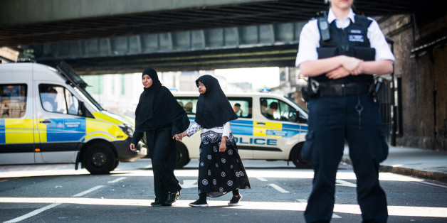 LONDON, UNITED KINGDOM - JUNE 19: A muslim woman and child hold hands and walk past police near the scene of the terror attack in Finsbury Park on June 19, 2017 in London, England. PHOTOGRAPH BY Adam Gray / Barcroft ImagesLondon-T:+44 207 033 1031 E:hello@barcroftmedia.com -New York-T:+1 212 796 2458 E:hello@barcroftusa.com -New Delhi-T:+91 11 4053 2429 E:hello@barcroftindia.com www.barcroftimages.com (Photo credit should read Adam Gray / Barcroft Images / Barcroft Media via Getty Images)