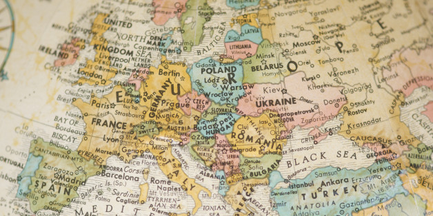 Selective focus view of vintage antique map of Europe on a faded sepia antique globe