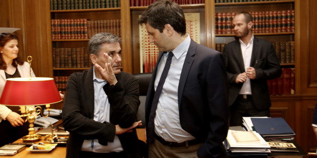 Greek Finanace Minister Euclid Tsakalotos (L) and George Chouliarakis, Alternate Finance Minister at Maximos mansion, in Athens on June 12, 2017 (Photo by Panayotis Tzamaros/NurPhoto via Getty Images)