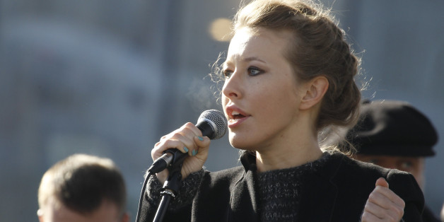 Television host and opposition activist Ksenia Sobchak delivers a speech during a demonstration for fair elections on Novy Arbat Street in central Moscow March 10, 2012. Several thousand Russians gathered in central Moscow on Saturday for a rally seen as a test of the opposition's ability to mount a sustained challenge to President-elect Vladimir Putin.   REUTERS/Sergei Karpukhin (RUSSIA  - Tags: POLITICS CIVIL UNREST ELECTIONS)