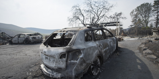 The remains of a burnt vehicle in front of a house in Sonoma County, California after the recent devastating fire. The wineries in the area are known for producing wine and wine tasting, October 17, 2017. (Photo by Yichuan Cao/NurPhoto via Getty Images)