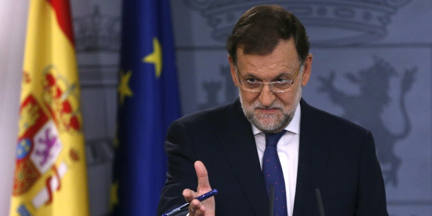 "Spain's Prime Minister Mariano Rajoy gestures during a news conference at Moncloa Palace in Madrid, Spain, September 28, 2015. Rajoy said on Monday he was ready to collaborate with the next Catalan government and hold talks on a wide range of issues but always ""within the law."" Catalan separatists said they had won a mandate to move forward with independence and called on the government on Monday to accept a democratic referendum on the issue.   REUTERS/Juan Medina      TPX IMAGES OF THE DAY"