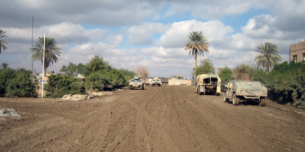 'Mud-clogged road in Ramadi, Iraq'