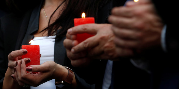 People hold candles as they gather for a candlelight vigil in memory of Malta's journalist Daphne Caruana Galizia in Brussels, Belgium, October 18, 2017.  REUTERS/Yves Herman
