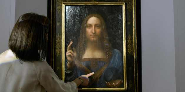 A Christies representative speaks after Leonardo da Vinci's 'Salvator Mundi' painting was unveiled in Hong Kong on October 13, 2017.  / AFP PHOTO / Anthony WALLACE / RESTRICTED TO EDITORIAL USE - MANDATORY MENTION OF THE ARTIST UPON PUBLICATION - TO ILLUSTRATE THE EVENT AS SPECIFIED IN THE CAPTION        (Photo credit should read ANTHONY WALLACE/AFP/Getty Images)