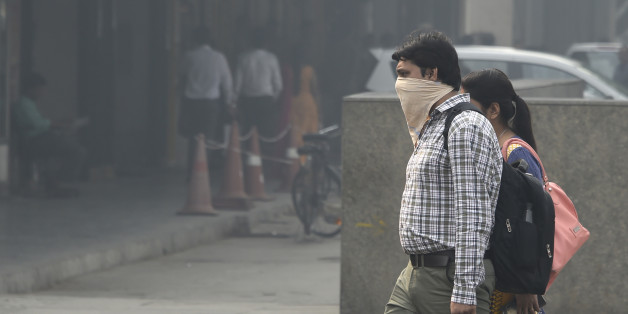 An Indian pedestrian protects his face in heavy smog in New Delhi on October 20, 2017 the day after the Diwali Festival.New Delhi was shrouded in a thick blanket of toxic smog a day after millions of Indians lit firecrackers to mark the Diwali Festival. / AFP PHOTO / DOMINIQUE FAGET        (Photo credit should read DOMINIQUE FAGET/AFP/Getty Images)