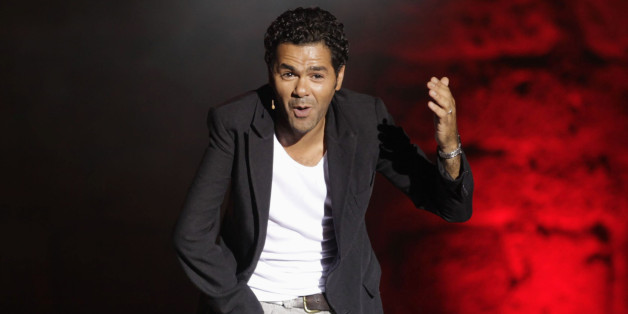 French comedian Jamel Debbouze performs during the Carthage International Festival at the Carthage Roman ruins in Tunis, August 2, 2012. REUTERS/Zoubeir Souissi (TUNISIA - Tags: ENTERTAINMENT SOCIETY)