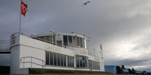 A seagull flies above the Labworth Cafe, designed by the engineer Ove Arup and built in the 1930s to echo the bridge of the Queen Mary ocean liner, at the seafront on Canvey Island, Essex on October 20, 2017.A small island community in the Thames Estuary that voted massively for Brexit is now looking to distant Catalonia as inspiration for its own plans to separate from the mainland. / AFP PHOTO / Daniel LEAL-OLIVAS        (Photo credit should read DANIEL LEAL-OLIVAS/AFP/Getty Images)