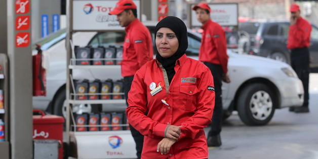A female employee is seen as she works at a petrol station in Cairo, Egypt, February 24, 2016. A petrol station in the Egyptian capital Cairo hires women to work as attendants - until now, petrol stations were staffed almost exclusively by men. Picture taken February 24, 2016. REUTERS/Mohamed Abd El Ghany
