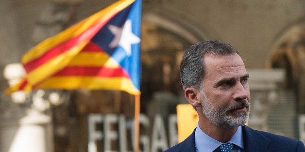 BARCELONA, SPAIN - AUGUST 26:  King Felipe VI of Spain arrives to a demonstration against the last week's terrorist attacks next to a Catalonia Pro-Independence flag in the background on August 26, 2017 in Barcelona, Spain. Hundreds of thousands people have marched in central Barcelona for the 'No tinc Por' (I am not afraid) joining in solidarity with the 14 victims of last week's terrorists attacks in Barcelona and Cambrils. 14 people were killed and dozens of injured in two terrorist attacks o