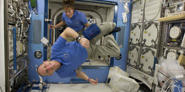 (L-R) Astronauts Clayton Anderson and Dorothy Metcalf-Lindenburger are pictured in the Kibo laboratory of the International Space Station in this image provided by NASA and taken April 14, 2010. Picture taken April 14.        REUTERS/NASA/Handout    (UNITED STATES - Tags: SCI TECH) FOR EDITORIAL USE ONLY. NOT FOR SALE FOR MARKETING OR ADVERTISING CAMPAIGNS
