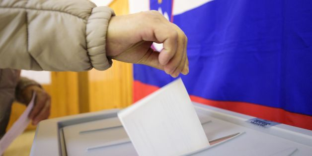 A slovenian citizen casts her ballot for the first round of the presidential election at a polling station in Ljubljana, on October 22, 2017.