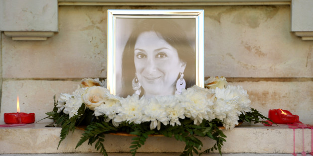 Flowers and tributes lay at the foot of the Great Siege monument in Valletta, Malta, on October 19, 2017 which has been turned into a temporary shrine for Maltese journalist and blogger Daphne Caruana Galizia (picture) who was killed by a car bomb outside her home in Bidnjia, Malta, on October 16, 2017. / AFP PHOTO / Matthew Mirabelli        (Photo credit should read MATTHEW MIRABELLI/AFP/Getty Images)