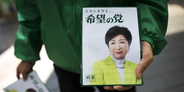 In this picture taken on October 18, 2017, a man distributes electoral leaflets of Tokyo Governor and leader of the Party of Hope Yuriko Koike during an election campaign in Saitama.Tokyo governor Yuriko Koike is a media-savvy veteran who has charmed her way through Japan's male-dominated politics and transformed its sleepy political landscape with a wildcard new party that caught everyone off-guard. Koike stunned the establishment by unveiling her new conservative 'Party of Hope', seeking to of