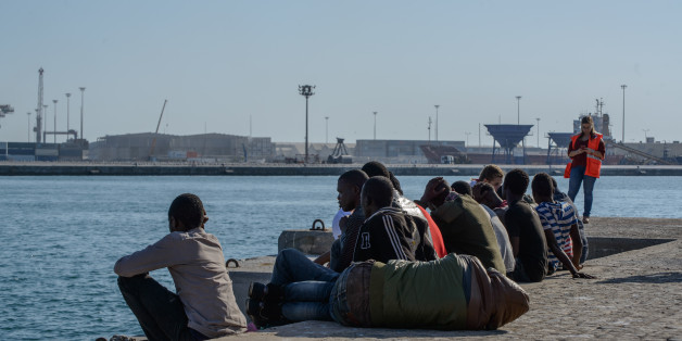 Migrants recovering at the Malaga harbor, Spain, on 9 October 2017 after being rescued by the Spanish Maritine boat.  55 migrants, among them, 15 women and 9 minores, were rescued in the Mediterranean sea by the Spanish Maritine authority. They were brought to the Malaga harbour where the Red cross team welcomed and provided them with a medical assessment. One person was brought to the hospital. (Photo by Guillaume Pinon/NurPhoto via Getty Images)