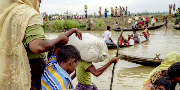 """An estimated of 10,000 Rohingya were stranded for three days in """"no man's land"""", the area between the Myanmar and Bangladeshi borders. From a settlement near Anjuman Para, they are seen walking to makeshift refugee camps near Ukhiya in Bangladesh on October 19th, 2017.  (Photo by Jade Sacker/NurPhoto via Getty Images)"""
