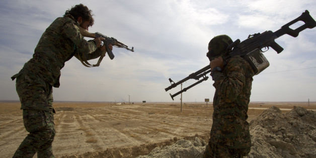 North-East of Syria, Rojava: The Kobani canton, in the Federation of Northern Syria - Rojava, more commonly known as Syrian Kurdistan or Western Kurdistan, struggles against Daesh. Here, two armed soldiers of the People's Protection Units (YPG) near the front line. (Photo by: Andia/UIG via Getty Images)