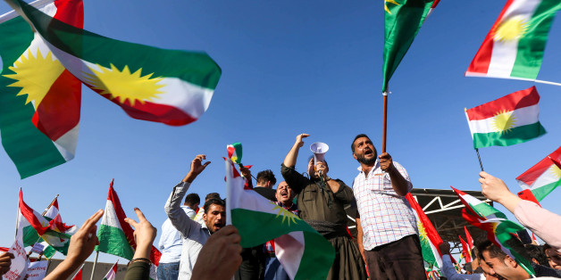 Iraqi Kurds wave flags of Iraqi Kurdistan and shout slogans during a demonstration outside the UN Office in Arbil, the capital of the autonomous region, on October 21, 2017, protesting against the escalating crisis with Baghdad. / AFP PHOTO / SAFIN HAMED        (Photo credit should read SAFIN HAMED/AFP/Getty Images)
