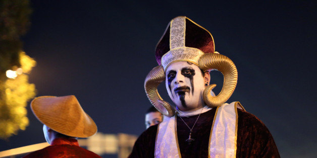 Revellers celebrate in costume at the West Hollywood Halloween Carnaval in West Hollywood, California, U.S., October 31, 2016. Picture taken October 31, 2016. REUTERS/David McNew