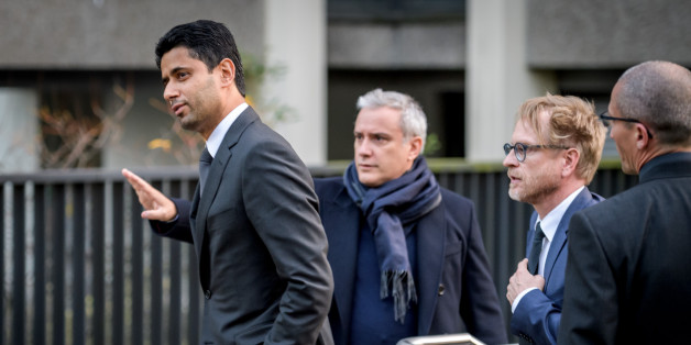 Paris Saint-Germain president and beIN Media chief Nasser al-Khelaifi (L) leaves the office of Swiss attorney general offices for a statment after his hearing on the latest World Cup corruption probe, on October 25, 2017 in Bern.Swiss prosecutors grilled Paris Saint-Germain president and beIN Media chief Nasser al-Khelaifi on October 25 over allegations that he obtained World Cup media rights by bribing a top FIFA executive.  / AFP PHOTO / Fabrice COFFRINI        (Photo credit should read FABRIC