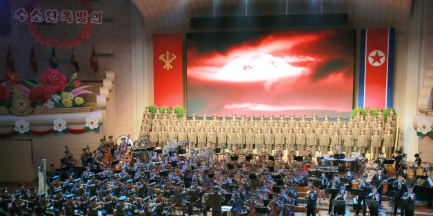 People perform for North Korean leader Kim Jong Un during a celebration for nuclear scientists and engineers who contributed to a hydrogen bomb test, in this undated photo released by North Korea's Korean Central News Agency (KCNA) in Pyongyang on September 10, 2017. KCNA via REUTERS   ATTENTION EDITORS - THIS PICTURE WAS PROVIDED BY A THIRD PARTY. REUTERS IS UNABLE TO INDEPENDENTLY VERIFY THE AUTHENTICITY, CONTENT, LOCATION OR DATE OF THIS IMAGE. NO THIRD PARTY SALES. SOUTH KOREA OUT. NO COMMERCIAL OR EDITORIAL SALES IN SOUTH KOREA. THIS PICTURE IS DISTRIBUTED EXACTLY AS RECEIVED BY REUTERS, AS A SERVICE TO CLIENTS.