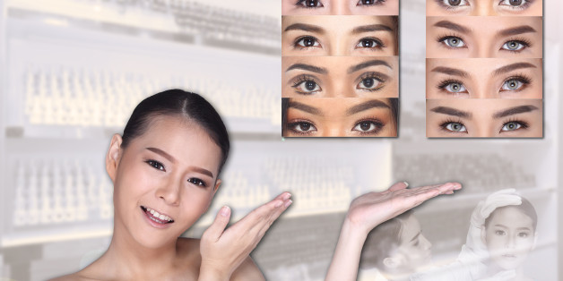 Young White Asian woman show empty copy space on the hand palm with clinic background, Concept Beauty Medical service permanent tattooing on eyebrow many style