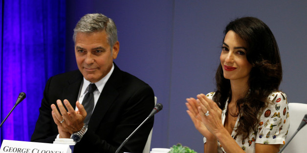Actor George Clooney and his wife Amal attend a CEO roundtable at the United Nations during the United Nations General Assembly in New York September 20, 2016. REUTERS/Kevin Lamarque