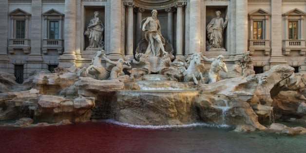 ROME, ITALY - OCTOBER 26: A blood-red dye was poured by public-artist Graziano Cecchini into the Trevi's fountain (Fontana di Trevi) as demonstrative act on October 26, 2017 in Rome, Italy. Rome police identified Graziano Cecchini and placed him under investigation for damaging a historical and artistic building.(Photo by Antonio Masiello/Getty Images)
