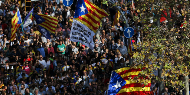 People holding Esteladas (Pro-independence Catalan flag) gather outside the Catalan parliament in Barcelona on October 27, 2017, during a plenary session to debate a motion on declaring independence from Spain.The Catalan parliament will vote on how to respond to the central government's planned takeover of Catalan political powers following an outlawed independence referendum. / AFP PHOTO / PAU BARRENA        (Photo credit should read PAU BARRENA/AFP/Getty Images)