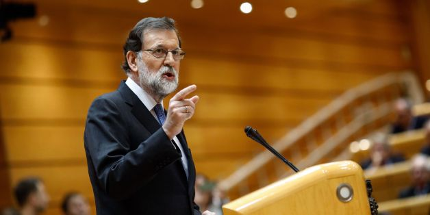 Spain's Prime Minister Mariano Rajoy gives a speech during a session of the Upper House of Parliament in Madrid on October 27, 2017.The central government has invoked the never-before-used article 155 of the Constitution, designed to rein in rebel regions, as it seeks to end Catalonia's drive to break from Spain. Spain's upper house is in charge of approving or rejecting the power seizure of the semi-autonomous Catalonia region proposed by Madrid.  / AFP PHOTO / OSCAR DEL POZO        (Photo cred