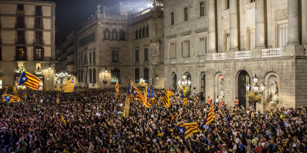 Pro-independence supporters gather at Sant Jaume square to celebrate following the parliamentary vote to declare Catalan independence in Barcelona, Spain, on Friday, Oct. 27, 2017. The resolution approved by lawmakers in Barcelona said the establishment of Europes newest sovereign country had been set in motion. Photographer: Angel Garcia/Bloomberg via Getty Images