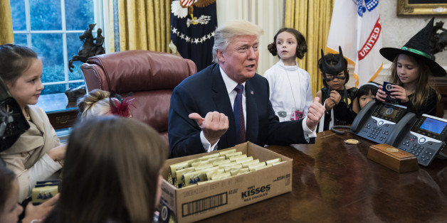 WASHINGTON, DC - OCTOBER 27: President Donald Trump meets with and hands out candy to children of journalists and White House staffers for Halloween in the Oval Office of the White House in Washington, DC on Friday, Oct. 27, 2017. (Photo by Jabin Botsford/The Washington Post via Getty Images)