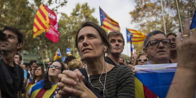 Pro independence supporters react as they wait outside the Catalan parliament for the result of a vote for independence in Barcelona, Spain, on Friday, Oct. 27, 2017. Catalonia is headed for a dramatic confrontation with Spain after the insurgent regions parliament voted to declare independence and the government in Madrid gained the power to oust its separatist leadership. Photographer: Guillem Sartorio/Bloomberg via Getty Images