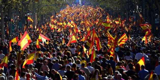 People wave Spanish and Catalan Senyera flags during a pro-unity demonstration in Barcelona on October 29, 2017. Pro-unity protesters were to gather in Catalonia's capital Barcelona, two days after lawmakers voted to split the wealthy region from Spain, plunging the country into an unprecedented political crisis. / AFP PHOTO / PIERRE-PHILIPPE MARCOU        (Photo credit should read PIERRE-PHILIPPE MARCOU/AFP/Getty Images)