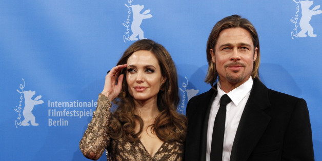 U.S. actress and director Angelina Jolie and her partner actor Brad Pitt arrive for the screening of the movie 'The Land Of Blood And Honey' at the 62nd Berlinale International Film Festival in Berlin February 11, 2012.  REUTERS/Fabrizio Bensch (GERMANY  - Tags: ENTERTAINMENT)