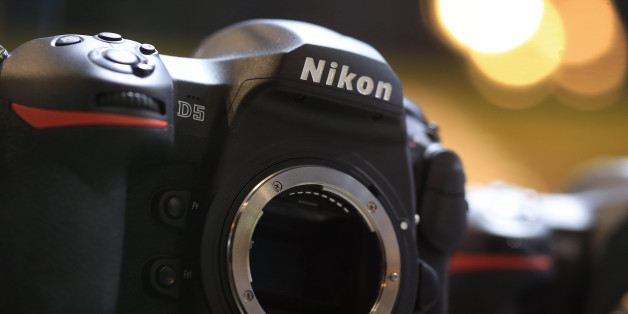 A Nikon Corp. D5 digital single lens reflex (DSLR) camera body sits on display at the Nikon stand, during the Photokina photography trade fair in Cologne, Germany, on Tuesday, Sept. 20, 2016. Photokina imaging trade fair takes place from September 20-25. Photographer: Krisztian Bocsi/Bloomberg via Getty Images