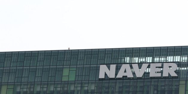 Naver Corp. signage is displayed atop the company's headquarters in Seongnam, South Korea, on Tuesday, April 28, 2015. Naver, the parent company of Line Corp., operator of Japan's most popular instant-messaging platform, is scheduled to report first-quarter results on April 30. Photographer: SeongJoon Cho/Bloomberg via Getty Images