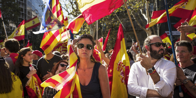 BARCELONA, SPAIN - OCTOBER 29: Spanish government supporters wave Spanish flags and carry banners during a large pro-unity demonstration on October 29, 2017 in Barcelona, Spain. Thousands gather in Barcelona, two days after the Catalan Parliament voted to split from Spain. The Spanish government has responded by imposing direct rule and dissolving the Catalan parliament.  on October 29, 2017 in Barcelona, Spain.  on October 29, 2017 in Barcelona, Spain. (Photo by Etienne De Malglaive/Getty Image