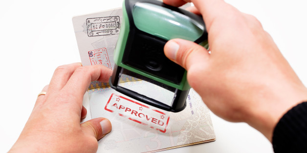 Stamping passport with red stamp approved