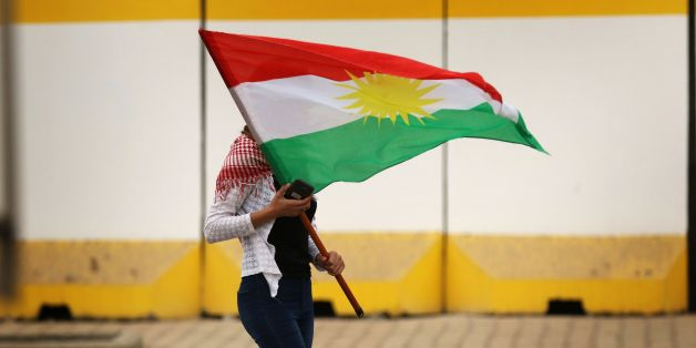An Iraqi Kurd marches with a Kurdish flag during a protest in support of the Iraqi Kurdish leader, in Arbil, the capital of autonomous Iraqi Kurdistan, on October 30, 2017.  Long-time Kurdish leader Massud Barzani, the architect of the referendum, announced on October 29, 2017 he is stepping down after it led to Iraq's recapture of almost all disputed territories that had been under Kurdish control. / AFP PHOTO / SAFIN HAMED        (Photo credit should read SAFIN HAMED/AFP/Getty Images)