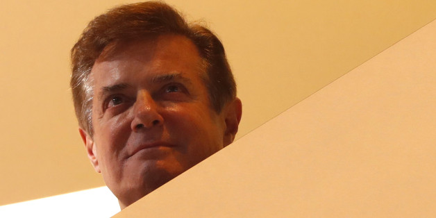 Donald Trump's campaign manager Paul Manafort looks down from the of the stage as Trump celebrates below after his acceptance speech at the Republican National Convention in Cleveland, Ohio, U.S. July 21, 2016. REUTERS/Aaron P. Bernstein