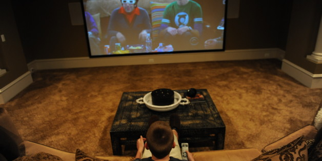 LEESBURG, VA - MARCH 25: Cole Pendergrast watches TV in the family's basement theater room at the family home on March 25, 2010, in Leesburg, VA.  The Pendergrast family is one of several families to be recently filmed for MTV's 'Teen Cribs' -- the popular wish-fufillment show where wealthy teens show off their palatial homes.  (Photo by Jahi Chikwendiu/The Washington Post via Getty Images)