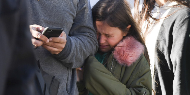 A young girl reacts as police officers secure an area following a shooting incident in New York on October 31, 2017. 