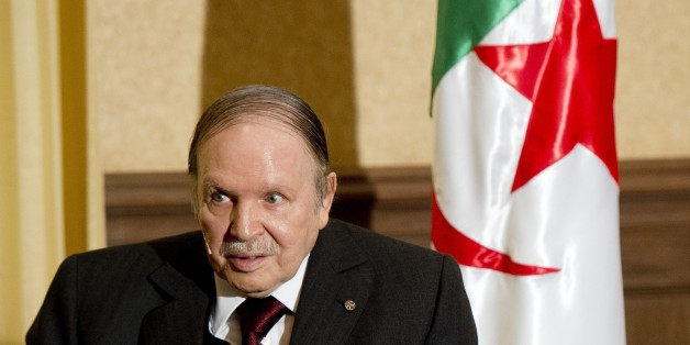 Algerian President Abdelaziz Bouteflika meets with his French counterpart Francois Hollande at the Zeralda private residence on June 15, 2015, in Algiers. Hollande is on a friendship and working visit to Algeria at the invitation of Algerian President, Abdelaziz Bouteflika as the two nations, once bitter foes, work ever closer to tackle regional threats from Mali to Libya. AFP PHOTO / POOL / ALAIN JOCARD / AFP / POOL / ALAIN JOCARD        (Photo credit should read ALAIN JOCARD/AFP/Getty Images)