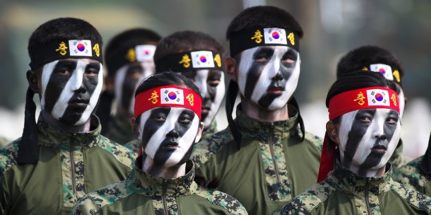This picture taken on September 25, 2017 shows South Korean Special Army soldiers performing martial arts during a media day presentation of a commemoration event marking South Korea's Armed Forces Day, which will fall on October 1, at the Second Fleet Command of Navy in Pyeongtaek.  / AFP PHOTO / JUNG Yeon-Je        (Photo credit should read JUNG YEON-JE/AFP/Getty Images)