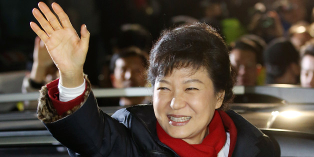 South Korea's president-elect Park Geun-Hye from the ruling New Frontier Party, waves to supporters outside the party headquarters in Seoul on December 19, 2012.  South Korea elected its first female president on December 19, handing a slim but historic victory to conservative ruling party candidate Park Geun-Hye, daughter of the country's former military ruler.  REPUBLIC OF KOREA OUT    AFP PHOTO/DONG-A ILBO        (Photo credit should read DONG-A ILBO/AFP/Getty Images)