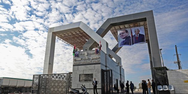 Portraits of Egyptian President Abdel Fattah al-Sisi and Palestinian leader Mahmud Abbas hang at the Rafah border crossing with Egypt on November 1, 2017. Hamas handed over control of the Gaza Strip's border with Egypt to the Palestinian Authority today, a first key test of a Palestinian reconciliation agreement agreed last month, an AFP journalist said. / AFP PHOTO / SAID KHATIB        (Photo credit should read SAID KHATIB/AFP/Getty Images)