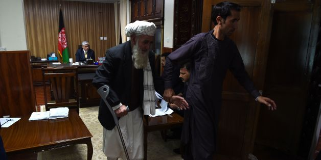 In this photograph taken on October 2, 2017 Abdul Qader, 75, leaves a petitioners' meeting at the Attorney General's office in Kabul.Since taking office in April 2016, Attorney General Farid Hamidi has been throwing open his doors to the public every October 28 in an effort to build confidence in the law and root out venal officials. Hamidi, a former member of the country's human rights commission, begins receiving the first of dozens of petitioners in his office at 8:00 a.m.  / AFP PHOTO / WAKI