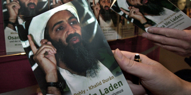 Two people examine the cover of a biography of Osama Bin Laden, written by the German author Michael Pohly and American Khalid Duran, at the Frankfurt book fair October 10, 2001. The biography which was published on October 2 is presented at the 53rd Frankfurt book fair, the world's largest fair for printed and electronic media, which runs from  October 10 until October 15.